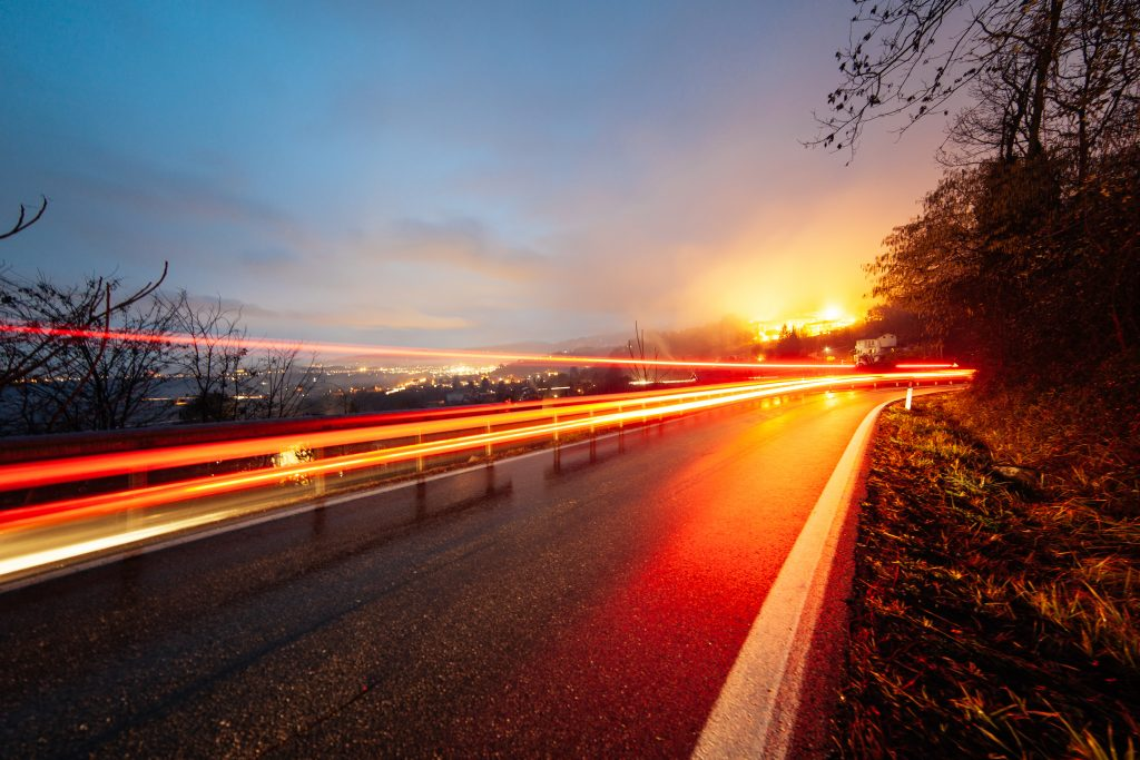 Road at night with lights, innovative, evolving, moving forward
