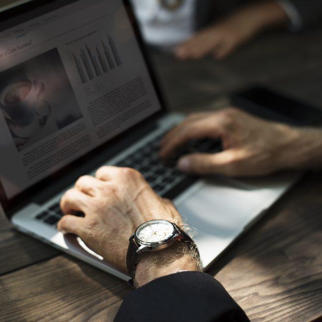 Man on a laptop doing online life coaching